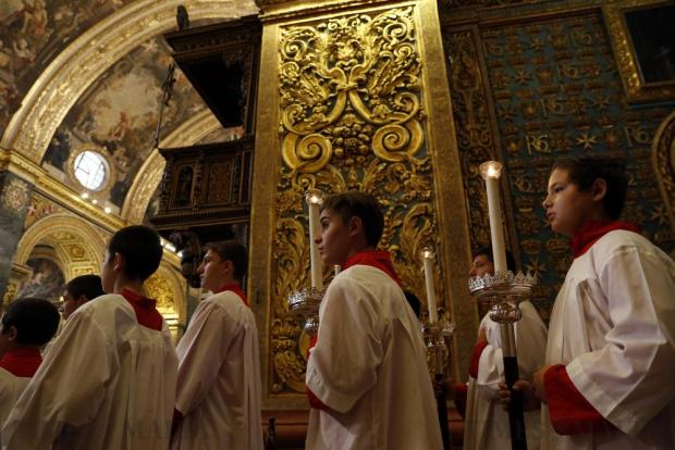 Altar boys take part in a procession during a High Mass to commemorate Independence Day at St John's Co-Cathedral in Valletta on September 21. Photo: Darrin Zammit Lupi