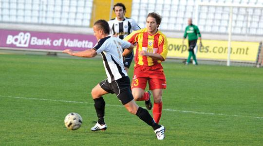 Hibernians forward Andrew Cohen runs past Emiliano Lattes, of Birkirkara, during Saturday's Premier League clash at the National Stadium. The Stripes won the match 3-1 to leave the troubled Paolites second from bottom in the table.