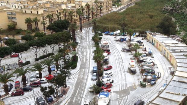Hail in Xlendi, Gozo. Photo: Mike Cressey