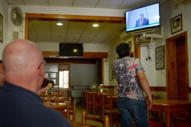 People watch the 13-hour debate on the Panama Papers and a related no-confidence motion in the government in parliament on a TV in the Labour Party club in Valletta on April 18. Photo: Matthew Mirabelli