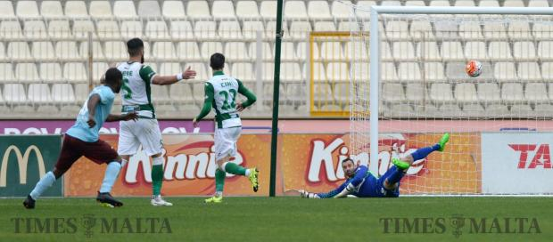 Gżira's Louis Zome (left) scores his team's fourth goal against Floriana at the National Stadium in Ta' Qali on January 29. Photo: Matthew Mirabelli