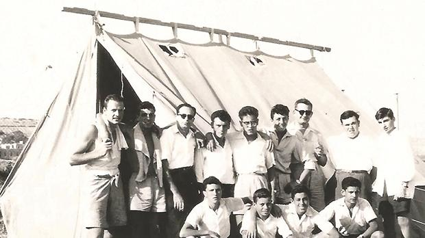 Fr John Sladden (standing, third from right) in 1959 during one of the summer camps.