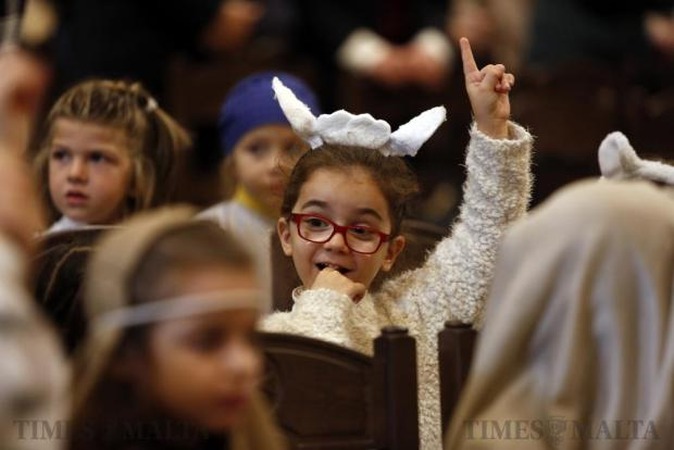 A child in a Nativity play costume attends a Mass for schoolchildren as part of the Milied Flimkien campaign in aid of the Community Chest Fund at St John's Co-Cathedral in Valletta on December 6. Photo: Darrin Zammit Lupi