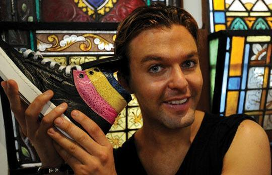 Rupert Noffs with Gideon shoes made from cane toads (coloured bands) and kangaroo hide. Photo: Torsten Blackwood/AFP