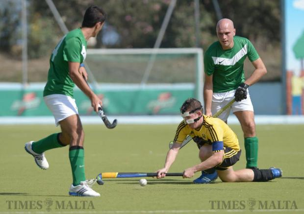 Players compete for the ball during the Super Cup final between Poiatti Qormi and Floriana Young Starts at the Kordin National Hockey Centre in Corradino on October 9. Photo: Matthew Mirabelli