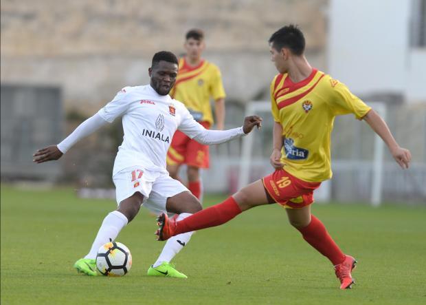 Umeh Calistus boots the ball forward against Senglea Athletic. Photo: Matthew Mirabelli.