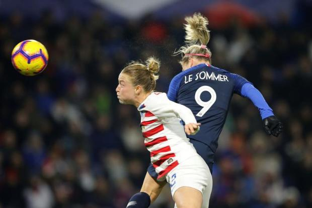 Emily Sonnett of the United States in action with France's Eugenie Le Sommer.