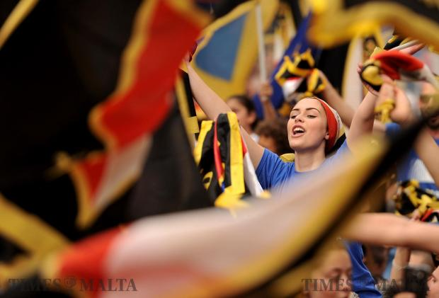 A girl waves her flag at the Nationalist Party mass meeting in Zebbug on May 14. Photo: Chris Sant Fournier