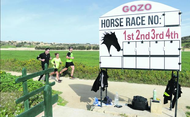 Triathletes jogging round the Ta' Xħajma horseracing track. Photo: Matthew Mirabelli