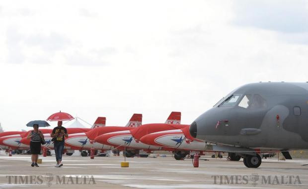 Dark rain clouds loom over the aircraft at the Malta International Airshow at Malta International Airport on September 25. Photo: Matthew Mirabelli