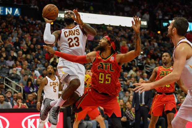 Cleveland Cavaliers forward LeBron James (23) shoots over Atlanta Hawks forward DeAndre' Bembry (95) during the first half at Philips Arena. Photo: Dale Zanine-USA TODAY Sports