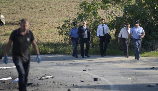 The victim's husband and son approaching the site right after the blast. Photo: Mark Zammit Cordina