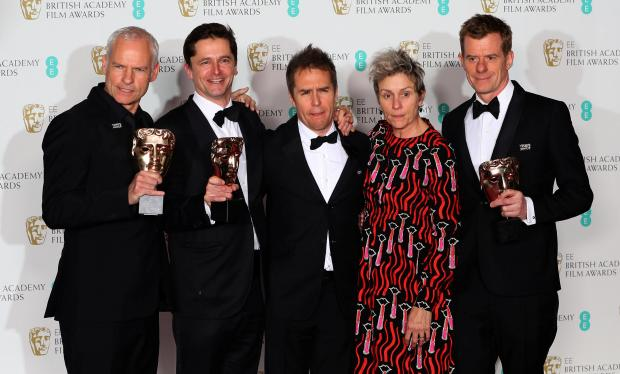 Martin McDonagh, Peter Czernin, Sam Rockwell and Graham Broadbent, pose with Frances McDormand, as they hold their trophies for Best Film for 'Three Billboards Outside Ebbing Missouri'.