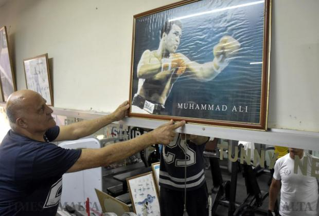 """Former boxer Bertu Camilleri paid tribute to legendary boxer Muhammad Ali by putting up an old poster of the American icon in the main hall of his gym in Għargħur on June 6. """"Cassius Clay, as he was originally known, taught boxing to the world and it is fitting to have his photo displayed for all to see,"""" Mr Camilleri said, as the sporting world mourned Ali's death. Photo: Mark Zammit Cordina"""