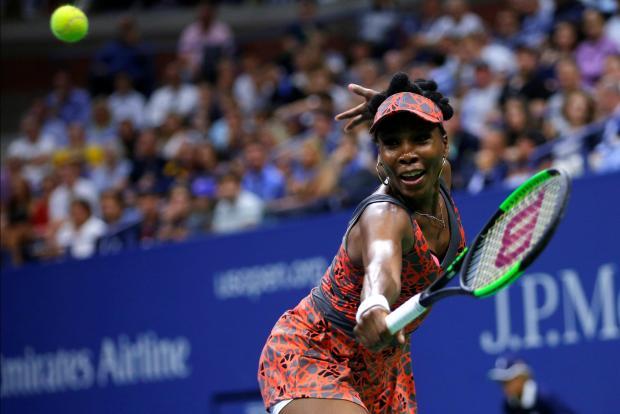 Venus Williams hits a return against Petra Kvitova at Flushing Meadows.