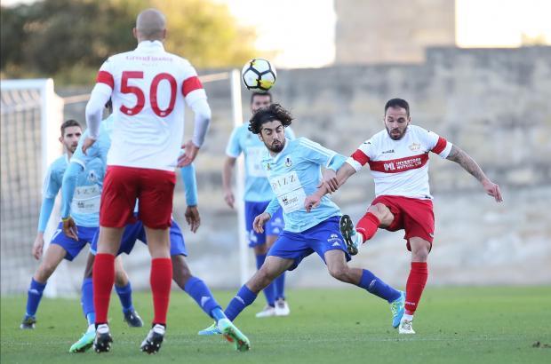 Balzan's Uros Ljubomirac boots the ball away against Sliema. Photo: Christine Borg