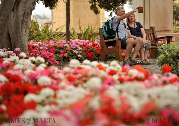 Tourists take a selfie at the Upper Barrakka Gardens on May 17. Photo: Chris Sant Fournier