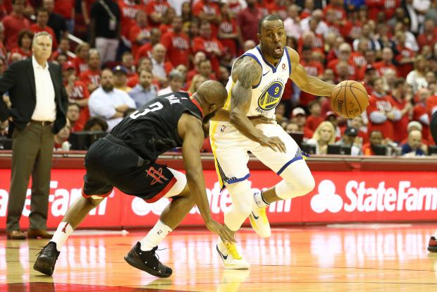 Golden State Warriors forward Andre Iguodala (9) drives against Houston Rockets guard Chris Paul (3) during the fourth quarter in game one of the Western conference finals of the 2018 NBA Playoffs at Toyota Center. Photo Credit: Troy Taormina-USA TODAY Sports