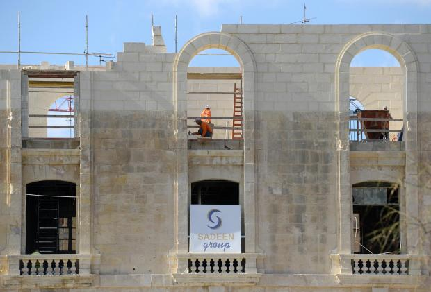 A man works on the façade of the American University of Malta at Dock 1 in Cospicua on January 30. Photo: Matthew Mirabelli