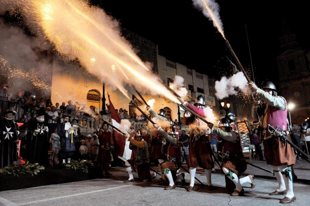 In Guardia performers fire their muskets during the St John Bonfire festivities in Mellieha on June 20. Photo: Chris Sant Fournier