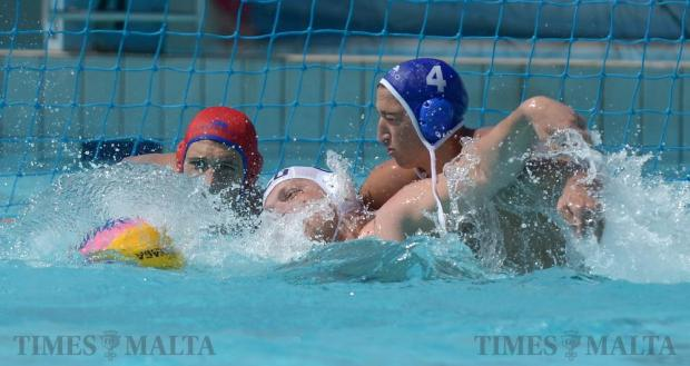 Malta's Nicholas Bugelli (right) tries to prevent Scotland from scoring a goal during a group waterpolo match at the EU Nations Cup on May 13. Malta was victorious, with a score of 19-1. Photo: Matthew Mirabelli
