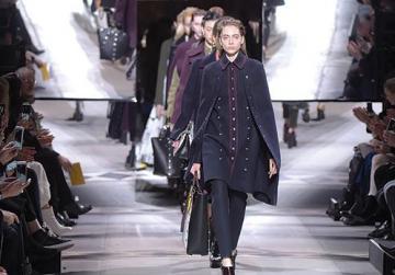 Handbag-wielding models on the Mulberry catwalk. Photo: WWD/Rex/Shutterstock