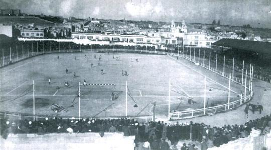 The Empire Stadium in its 1930s heydays. Note the wooden fence, built as part of a project to hold greyhound racing. The fence was removed in 1951 when the ground was given a general facelift.