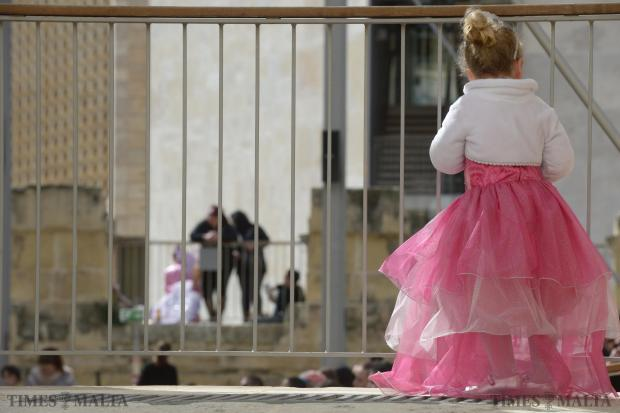 A young girl watches a carnival completion from outside the Pjazza Teatru Rjal in Valletta on February 9. Photo: Matthew Mirabelli