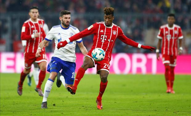 Bayern Munich's Kingsley Coman in action with Schalke's Daniel Caligiuri.