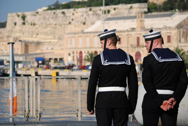 Sailors stand on the deck of the L.E. Eithne, an Irish Naval Service patrol vessel, in Valletta's Grand Harbour on July 7. The crew of the ship rescued almost 3400 migrants during its two-month deployment in the Mediterranean. Photo: Mark Zammit Cordina
