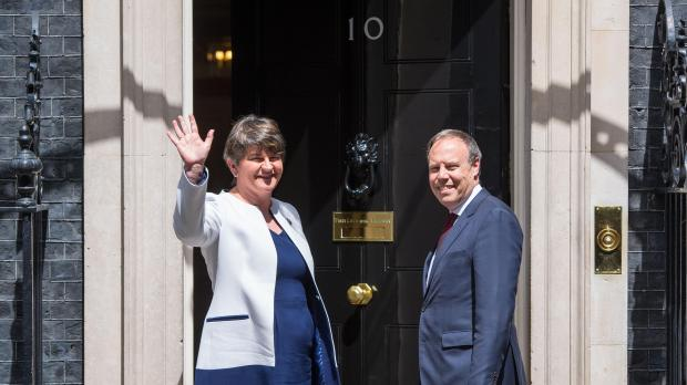 DUP leader Arlene Foster and DUP deputy leader Nigel Dodds arriving at 10 Downing Street.