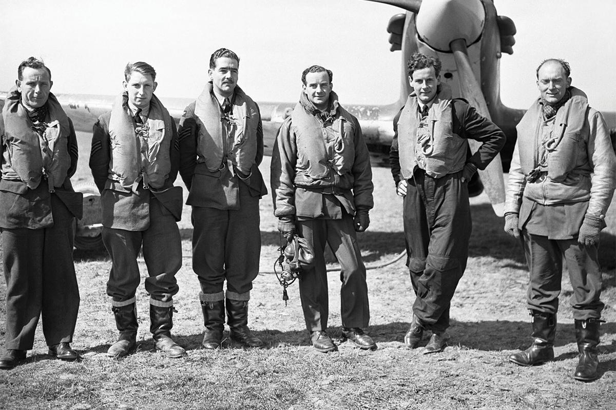 Pilots of No.43 Squadron based at Wick, Caithness, standing in front of a Hawker Hurricane Mark Is, April 1940. Source: Imperial War Museum