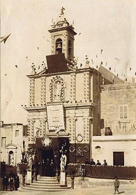 April 29, 1913: Mgr Vella is seen at the main door of Ta' Savina church awaiting the arrival of Cardinal Domenico Ferrata.