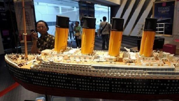 A visitor looking at the model of the original Titanic, displayed at an exhibition in Bangkok.