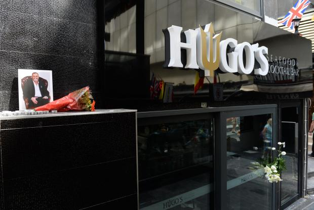 Tributes for Hugo Chetcuti outside one of his establishments.