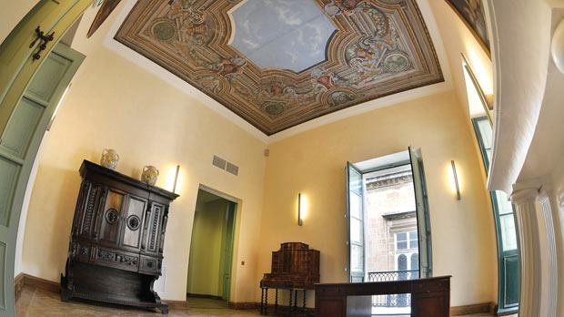 The first-floor corner room sports a frescoed ceiling, which was also restored.