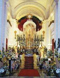 On Maundy Thursday (Ħamis ix-Xirka), there is a ancient tradition of visiting the seven churches where the Blessed Sacrament is placed at the Altar of Repose (Is-Sepulkru). Following the Mass of the Lord's Supper, the Blessed Sacrament is taken on a procession through the church and reposed in the tabernacle specially decorated with flowers and candles and in some places also with vetch (ġulbiena) for the adoration of the faithful. Photo shows the Altar of Repose at Mellieħa parish church, which has been taken care of by the parish's sexton Christopher Bartolo for the past 37 years. Mr Bartolo, with the help of four other men, starts putting up the decorations three days before Maundy Thursday. The choice of flowers and the flower arrangements are also the responsibility of Mr Bartolo.