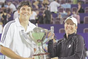 Lisa Raymond and Taylor Dent of the US hold aloft the Hopman Cup.