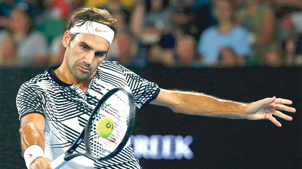 Roger Federer hits a shot back to Juergen Melzer, yesterday.