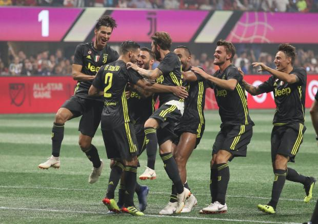 Juventus players celebrate their victory against the MLS All-Star team.