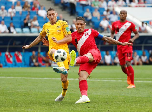 Peru's Paolo Guerrero scores their second goal.
