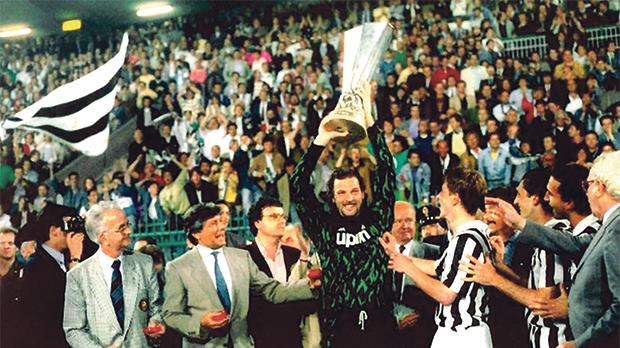 Stefano Tacconi lifts the UEFA Cup trophy for Juventus in 1990.