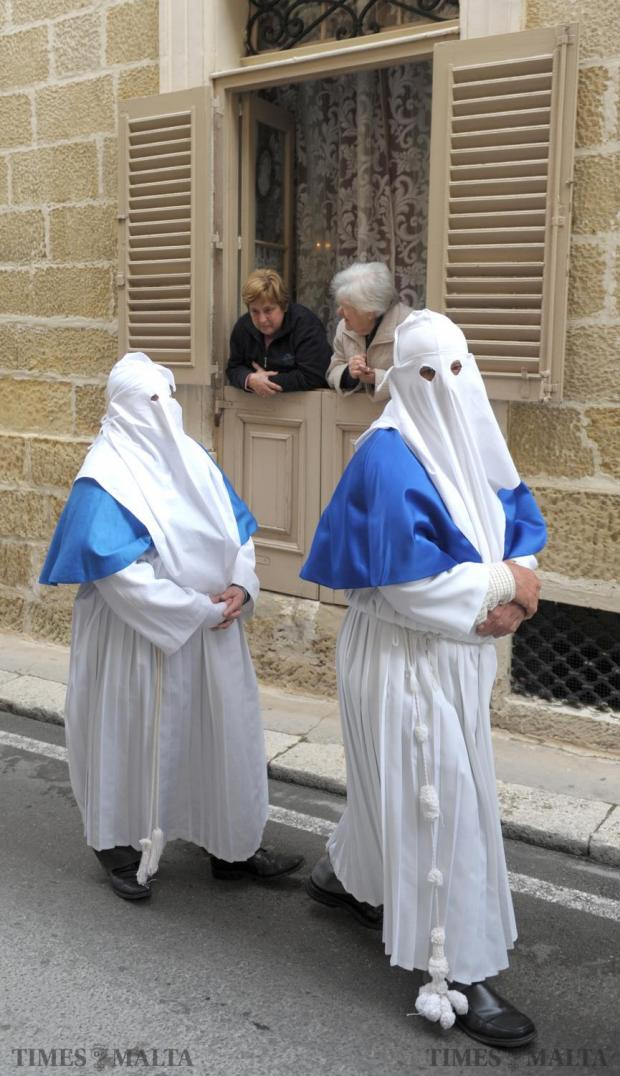 Two ladies enjoy the procession of San Girgor from the comfort of their home in Zejtun on April 4. Photo: Matthew Mirabelli