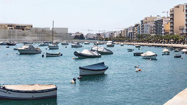 An official photomontage showing the view of some of the proposed apartment blocks from the Gżira promenade, with the original 1999 plans superimposed (faded).