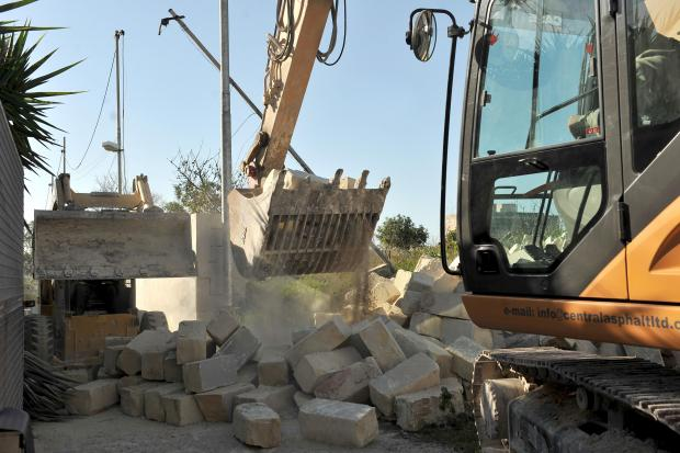 Heavy machinery demolishes an illegal factory used to house animals in Balzan on January 17. Photo: Chris Sant Fournier