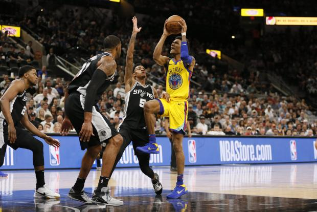 Golden State Warriors shooting guard Patrick McCaw (0) shoots the ball as San Antonio Spurs point guard Dejounte Murray (5) defends during the second half at AT&T Center. Photo Credit: Soobum Im-USA TODAY Sports