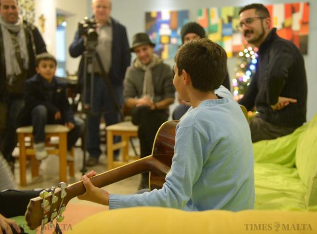 Boys at the St Joseph Home in Santa Venera were given a brand new guitar during a tête-à-tête with local band Red Electrick on December 14 Photo: Matthew Mirabelli