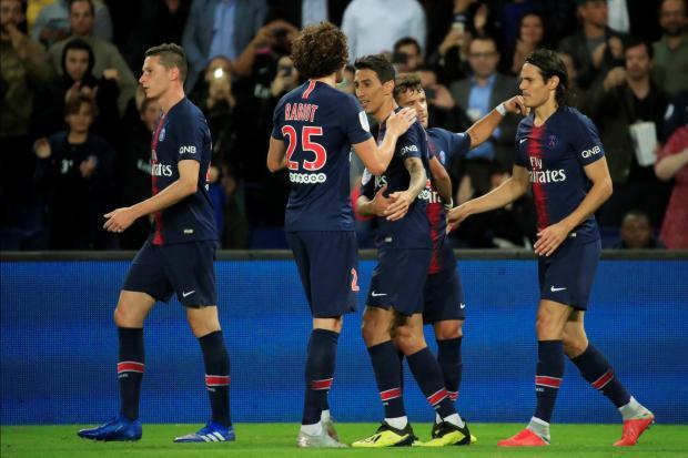 Paris St Germain's Angel Di Maria celebrates scoring their third goal.