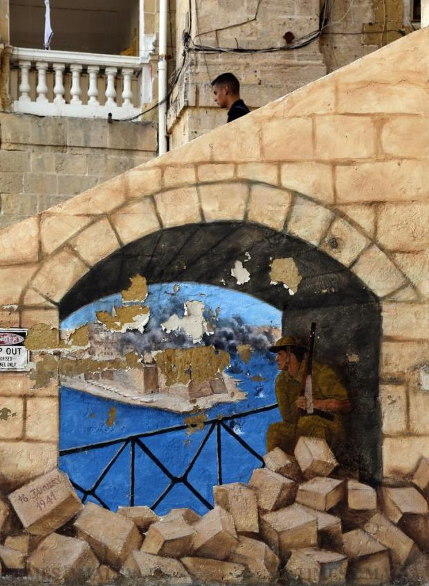 A mural depicting a scene showing Senglea during World War II Second World War is seen flaking away in Senglea on September 20. Photo: Darrin Zammit Lupi