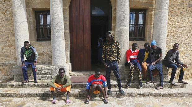 Adolescent migrants at the courtyard of an immigration centre in Caltagirone, Sicily. Photos: Alessandro Bianchi/Reuters